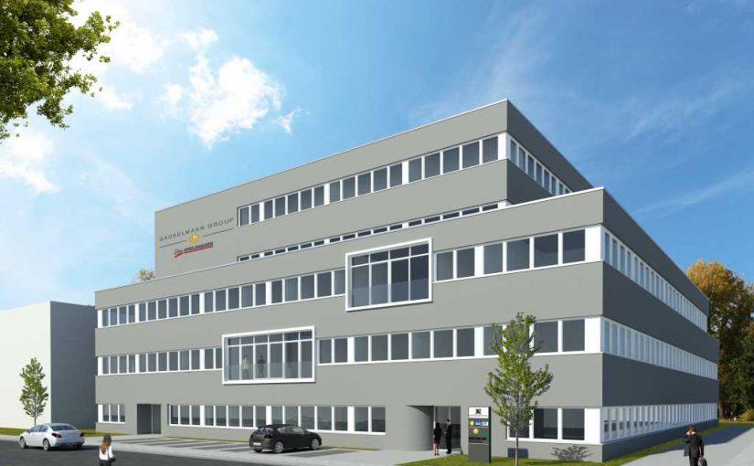 Das neue Gebäude in der Merkur-Allee in Espelkamp fügt sich harmonisch in die bestehende Gebäudefassade ein und sticht mit neuen Arbeitswelten in Form von offener, moderner Bürogestaltung heraus. - Bild: Gauselmann Gruppe